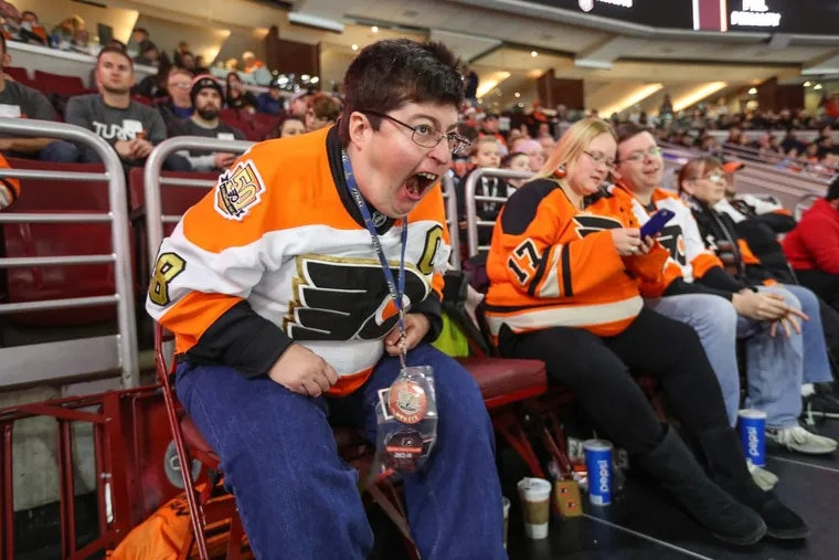Josh Silverman erupts with passion as the Philadelphia Flyers are about to score a goal during their home game against the Buffalo Sabres.