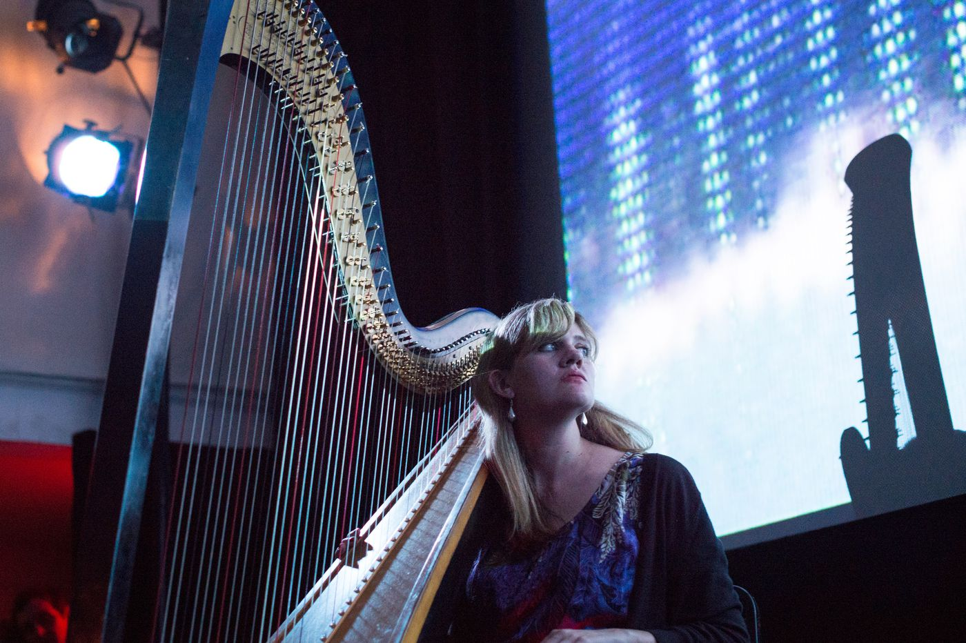 Mary Lattimore's harp makes all the guitar dudes jealous. But her instrument is also the reason she had to leave Philly