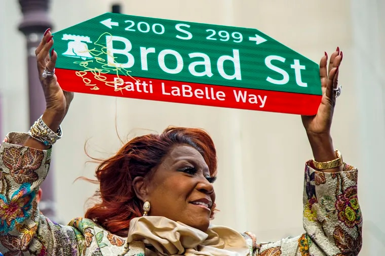 Patti LaBelle holds up a sign after signing it during a celebration July 2, 2019, while the block of Broad Street between Spruce and Locust Streets is renamed Patti LaBelle Way.