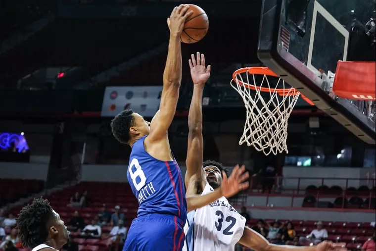 Zhaire Smith goes way up for a dunk in summer league play.