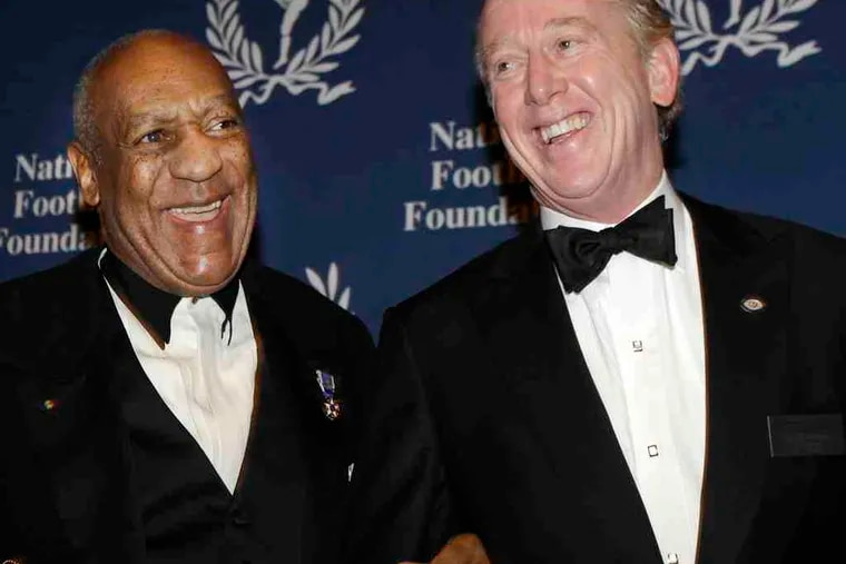 Comedian Bill Cosby (left) shares a light moment with National Football Foundation chairman Archie Manning at a cocktail reception before the College Football Hall of Fame awards dinner in New York on Tuesday. Cosby received the group's 2010 Gold Medal.