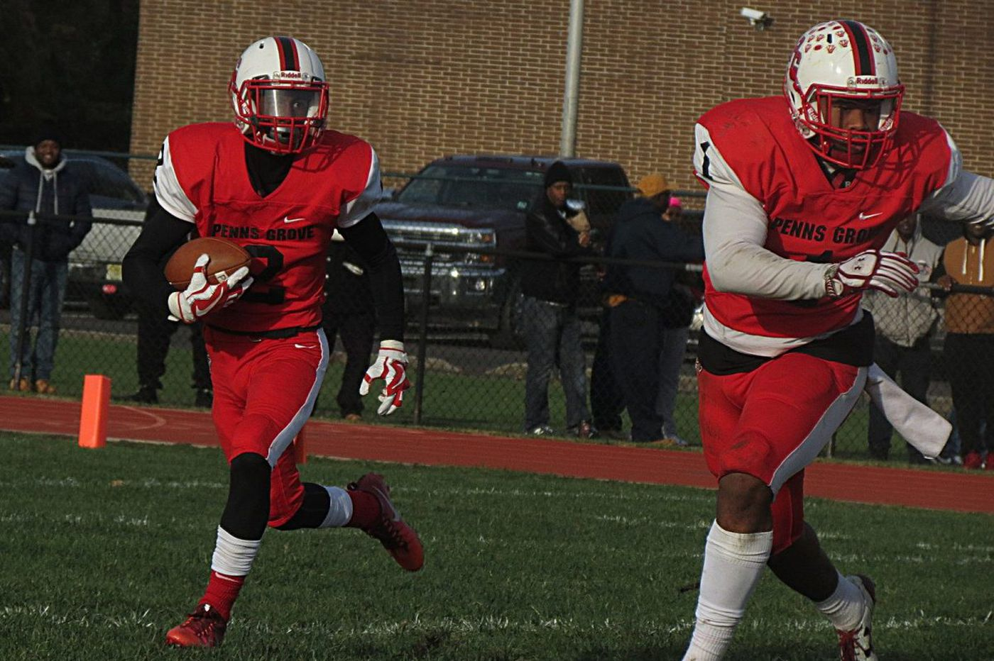 Red Devils beat Cougars in Group 1 football playoffs