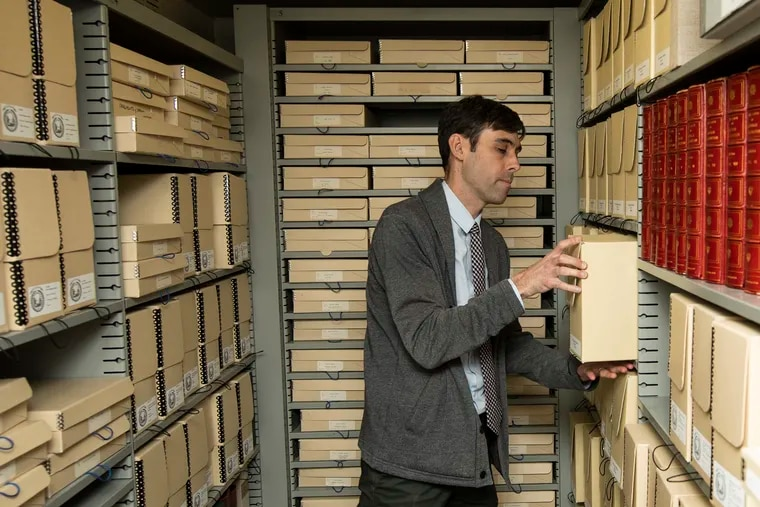 David Gary, APS' associate director of collections, amidst archive boxes packed with David Library documents housed at APS.