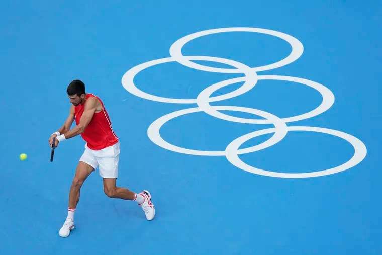 Novak Djokovic, of Serbia, practices for the men's tennis competition at the Tokyo Olympics on Thursday.