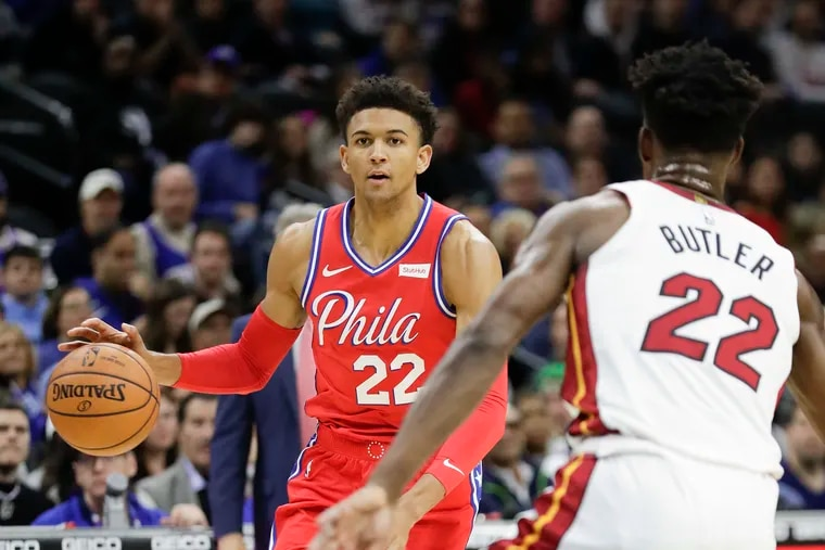 Sixers guard Matisse Thybulle dribbles the basketball in front of Miami Heat forward Jimmy Butler during the teams' meeting at the Wells Fargo Center in November.