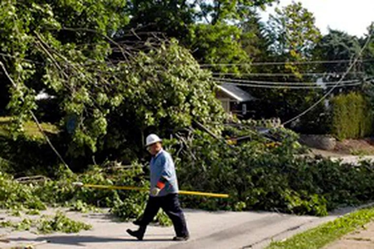 Peco employee Dave Sexton checks on downed wires he noticed in Abington while on his way home from an all-nighter to help restore power for nearly 70,000 customers. He alerted his office.