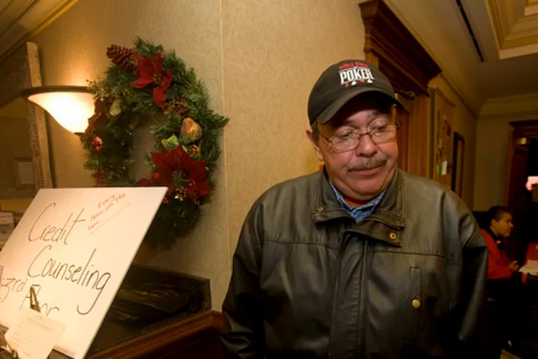 """Victor Torres, 49, lost his doorman's job at Ceasars in November. He says he's afraid his wife could be next: """"If she gets laid off, we will lose our house. We will lose everything."""""""