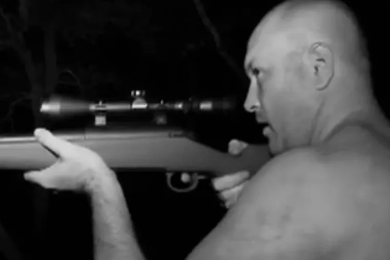 """An image of Rick Dyer supposedly aiming to kill a Bigfoot in San Antonio woods in September 2012, as seen in the film """"Shooting Bigfoot."""" The reported shooting prompted outrage by some who believe the species needs legal protection."""