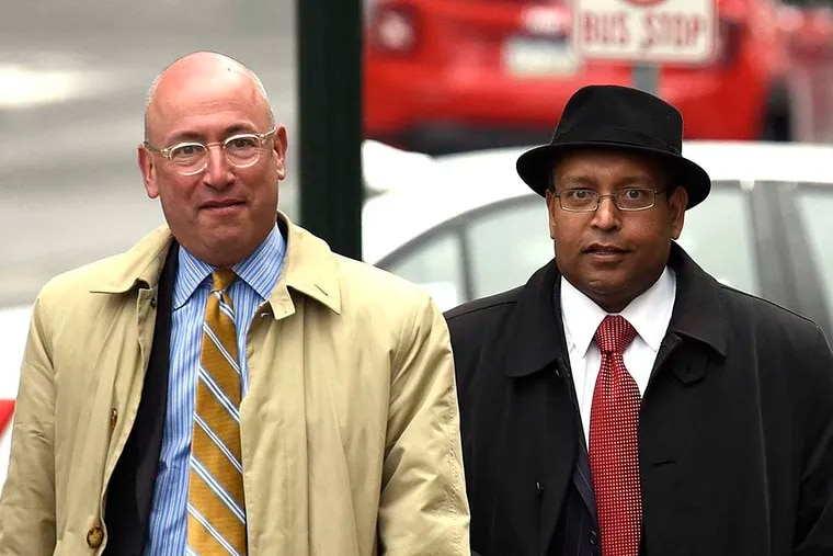 Tyron B. Ali, right, along with attorney Alan J.Tauber, left, arrive at the Dauphin County Court house for a hearing Monday, March 28, 2016 in Harrisburg