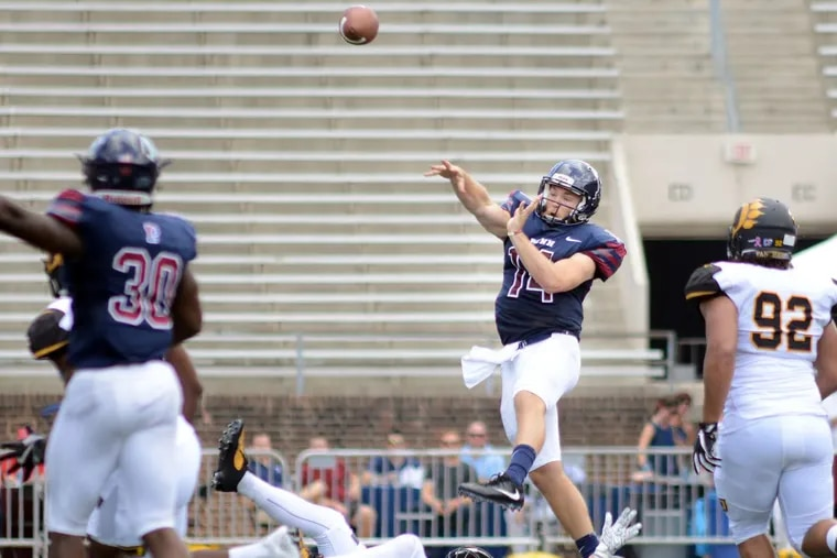 Penn quarterback Will Fischer-Colbrie (14) makes a pass after almost getting sacked against Ohio Dominican on Sept. 16 at Franklin Field.