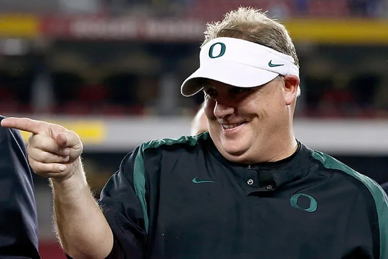 The Eagles have hired Chip Kelly as their new coach. (Ross Franklin/AP)
