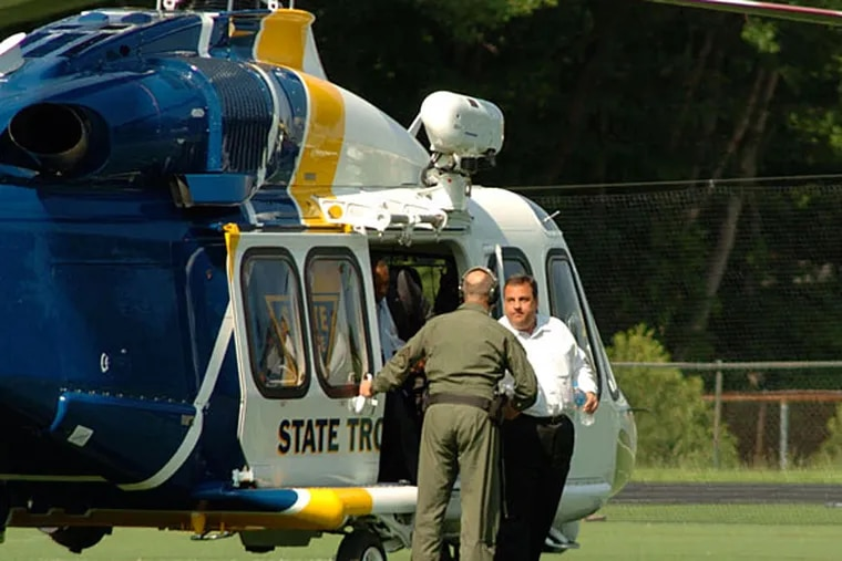 Gov. Christie arriving via state helicopter at Montvale, where he later watched his son's baseball game in 2011. He has said he uses the aircraft to balance his duties of work and home.