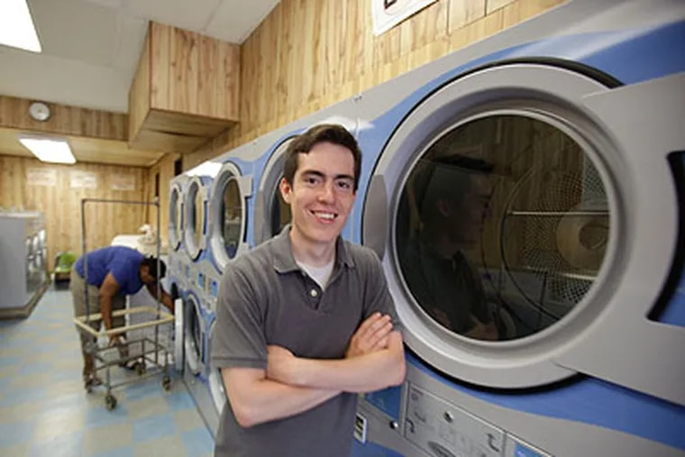 Gabriel Mandujano doesn't worry about rising gasoline prices at Wash Cycle Laundry. (DAVID SWANSON / Staff Photographer)