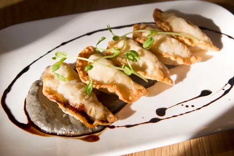 Mandoo dumplings at Southgate. They are fried beef dumplings with charred eggplant puree and soy balsamic reduction.