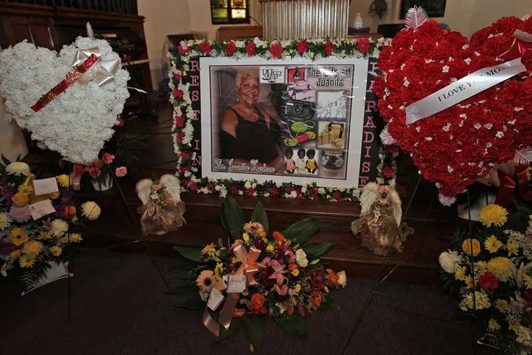 A display of pictures and flowers in front of the alter at City of Refuge Church during funeral service for Juanita Harmon.  Juanita Harmon is a Philadelphia woman killed inside the Salvation Army Thrift Store at Market St. and 22nd after a building collapsed into it. Her funeral was held at City of Refuge Church, 27th and Wharton St. in Grays Ferry section of Philadelphia on Thursday, June 13, 2013. ( ALEJANDRO A. ALVAREZ / STAFF PHOTOGRAPHER )