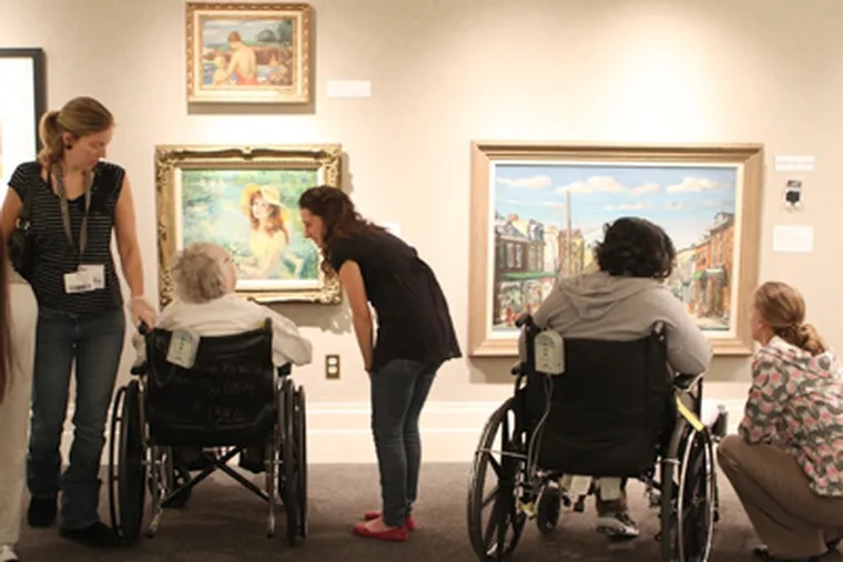 """Parkhouse residents tour Ursinus College's """"Art for Access"""" at the Berman Museum. The installation uses multi-sensory elements, such as Braille and 3D diagrams, for those with disabilities. (Charles Fox / Staff Photographer)"""