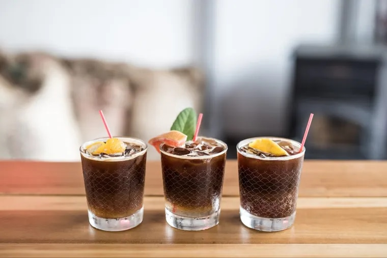 At Herman's Coffee, espresso tonics come in multiple variations, including seasonal flavors like Lavender Lemon and menu staples like Grapefruit Sage, as well as the Espressogrino, which swaps Fever-Tree Tonic for San Pellegrino Limonata (pictured left to right).
