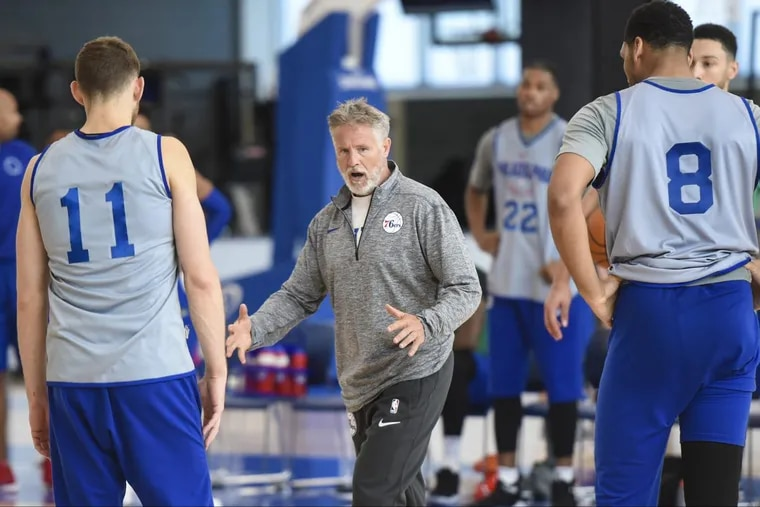 Sixers head coach Brett Brown (center) will have his hands full getting the Sixers rotations set for the opening tip-off.