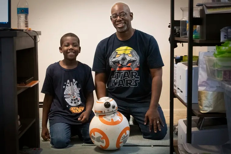 Keith Yarde (left) and his dad, Kerwin, at their King of Prussia home with their pal, BB-8.