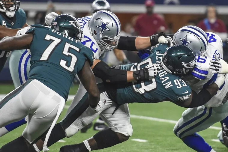 The Eagles defensive line, including Timmy Jernigan (No. 93) and Vinny Curry (No. 75), stops Cowboys running back Alfred Morris for a 1-yard gain during their 37-9 rout of Dallas earlier this season.