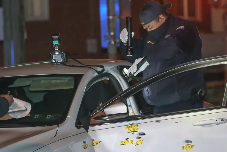 Police investigate a double shooting in the 1200 block of South 51st Street. The white car has at least 10 bullet holes in it. Police said two males, one age 21 and one approx. 16 were shot multiple times. Crime scene unit recover a handgun with an extended magazine from the car. Monday, December 28, 2020.