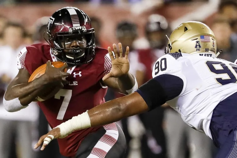 Temple running back Ryquell Armstead holds the football watching Navy defensive end Jarvis Polu during the second-quarter on Thursday, November 2, 2017 in Philadelphia. YONG KIM / Staff Photographer