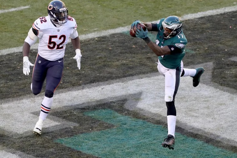 Eagles' Alshon Jeffery, right, catches a 2nd quarter touchdown pass in front of the Bears' Christian Jones, left. Philadelphia Eagles win 31-3 over the Chicago Bears in Philadelphia, PA on November 26, 2017. DAVID MAIALETTI / Staff Photographer