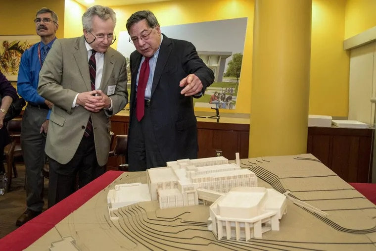 Joseph M. Field (right), 85, Central High School class of 192, speaks with architect Dan Kelley of MGA Partners, about a new performing arts center (foreground) to be built at the school thanks to a $10 million donation by Field and his wife Marie.  The building will be called the Joseph and Marie Field Performing Arts Center.