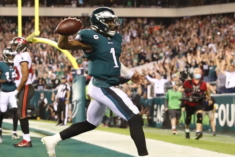 Eagles quarterback Jalen Hurts holds-up the football after scoring a third quarter touchdown run against the Tampa Bay Buccaneers on Thursday, October 14, 2021 in Philadelphia.