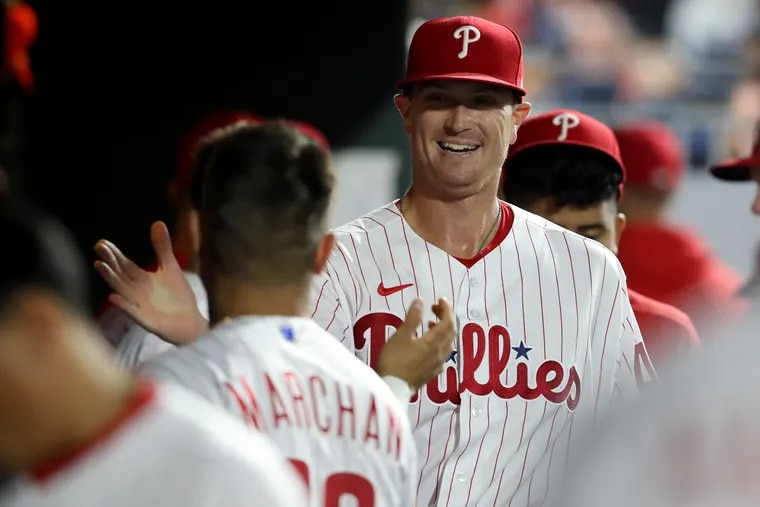 Kyle Gibson and Rafael Marchán of the Phillies congratulate each other after Gibson pitched six shutout innings against the Diamondbacks.