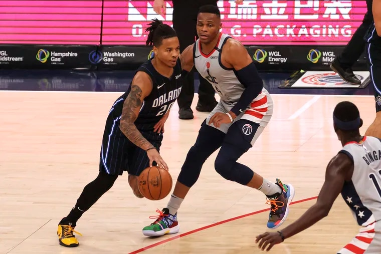 Former Sixers Markelle (20) drives to the basket past Washington Wizards guard Russell Westbrook (4) on Saturday. Fultz is averaging 18.3 points per game.
