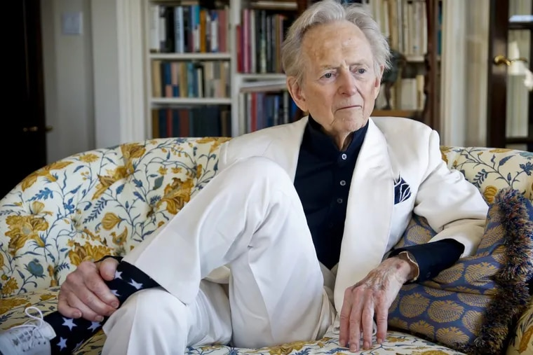 """American author and journalist Tom Wolfe, Jr. appears in his living room during an 2016 interview about his latest book, """"The Kingdom of Speech,"""" in New York. Wolfe died at a New York City hospital. He was 88."""