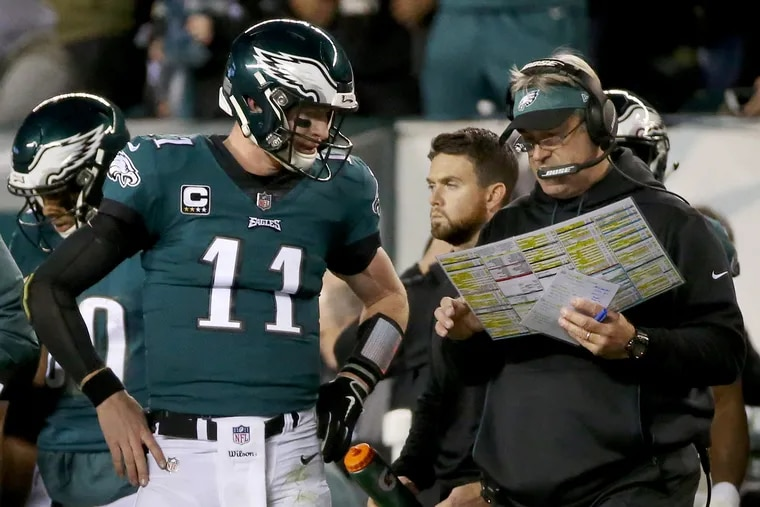 Eagles coach Doug Pederson with Carson Wentz during the Birds' win over Washington last Monday at Lincoln Financial Field.