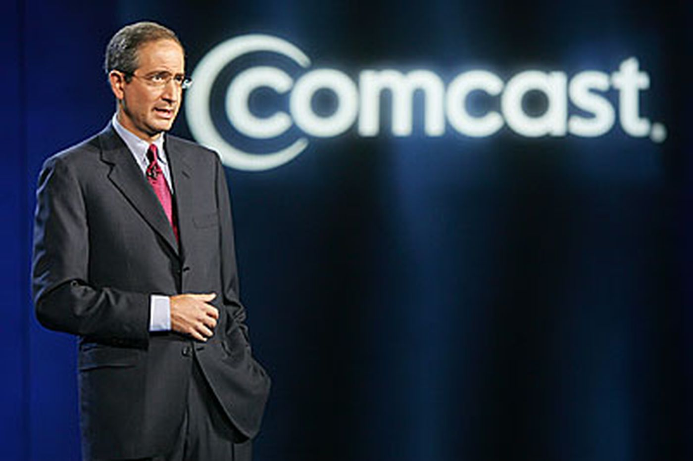FCC chief seeks action against Comcast