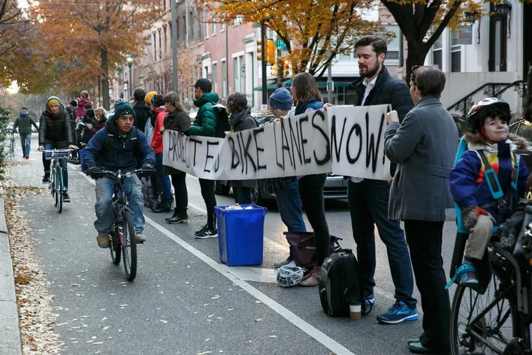 Protesters advocate for safer bike lanes by lining up at 11th and Spruce Streets on Wednesday. A cyclist's death has spurred debate about how Philadelphia could be safer for cyclists.