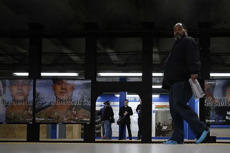 Commuters wait on the 15th Street Market-Frankford Line platform.