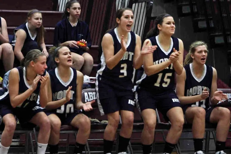 Players on the Council Rock North bench cheer their teammates during the 60-37 win. Lauren Gold led the Indians with 22 points.