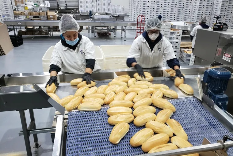 Workers at Liscio's Italian Bakery Inc. in Glassboro. The company employs 400, but some were laid off when hoagie shops were closed in the fight against the coronavirus. A PPP loan through TD Bank has enabled co-owner Charles (Chad) Vilotti to set rehiring plans.