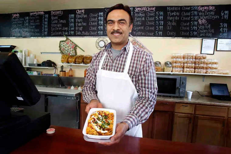 """Syed Hussain (left) with his """"Crazy Chaat"""" dish. Jars of chaat line the shelves at the restaurant (below)."""