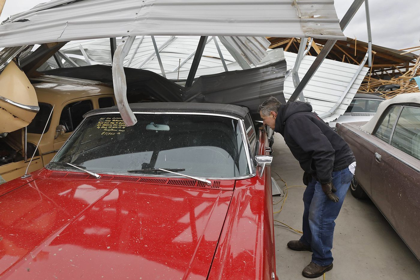 Residents continue assessing rare December tornado damage