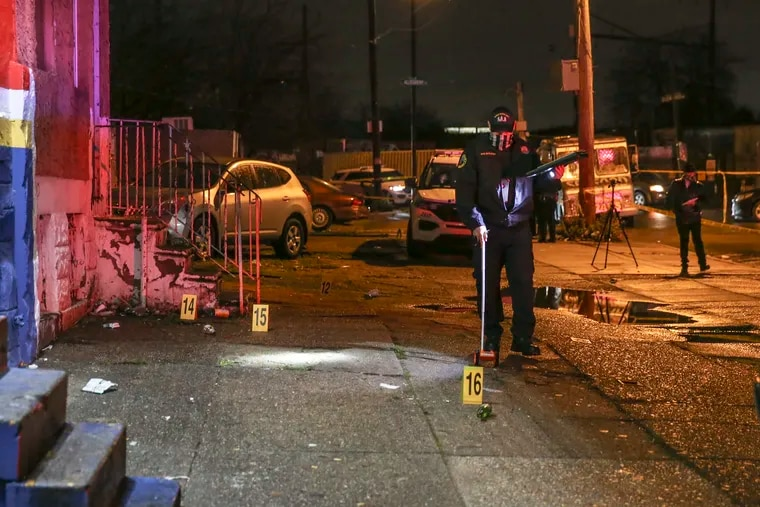 Crime scene officers gather evidence where two men were shot, one fatally in the 3100 block of N. Darien in the 25th police district, Friday, December 4, 2020
