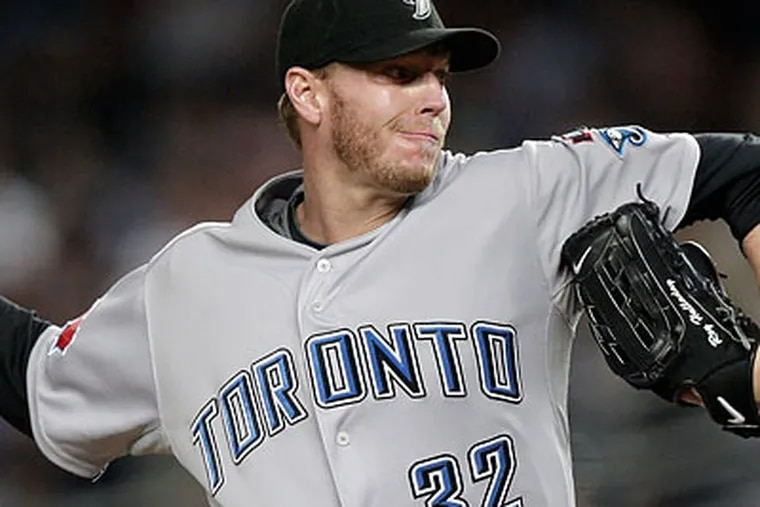 Are the Phillies giving up too much to acquire ace Roy Halladay? (Kathy Willens/AP file photo)