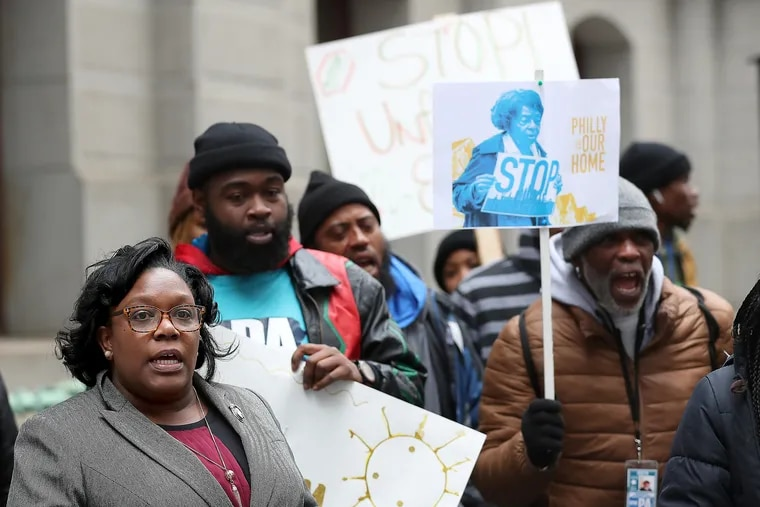 Councilwoman Kendra Brooks (left) joined demonstrators in a protest outside City Hall last February advocating for protections for renters and homeowners.