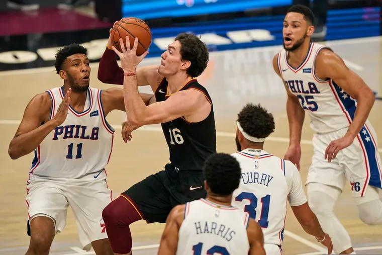 The Cavaliers' Cedi Osman (16) drives to the basket against the Sixers.