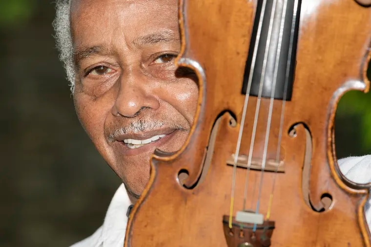 Booker Rowe with his violin at his home in Philadelphia. Rowe is retiring after 50 years in the Philadelphia Orchestra.