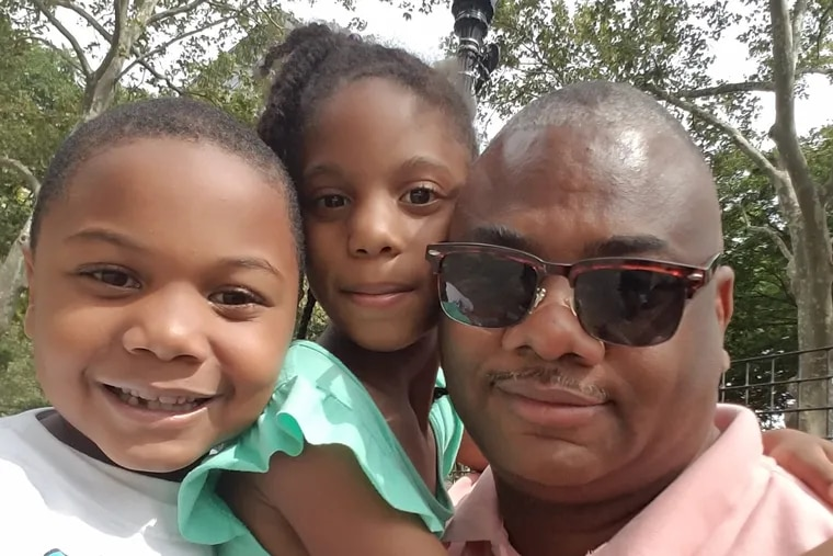 Reuben Jones, executive director of Frontline Dads, with his 8-year-old son Langston and his 10-year-old daughter Raegan.<br/> Courtesy Reuben Jones