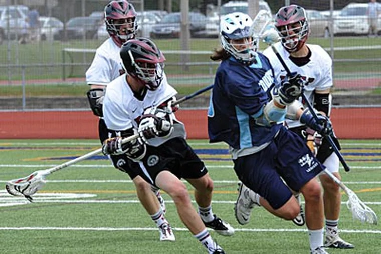 St. Joseph's Prep defenders pressure a Manheim Township player during their victory. ( April Saul / Inquirer )