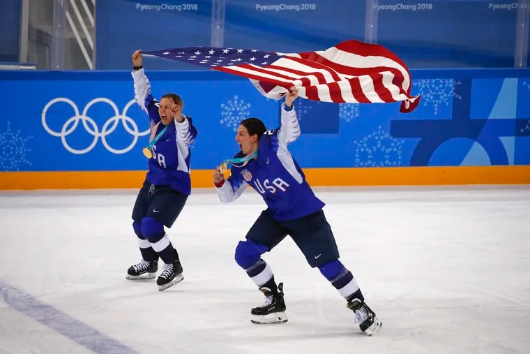 """United States' Kendall Coyne, left, and Hilary Knight celebrate after winning the women's gold medal hockey game against Canada at the 2018 Winter Olympics in Gangneung, South Korea, Two U.S. senators called on NBC on Thursday to refuse to air the 2022 Winter Olympics, citing China's """"abysmal record on human rights."""" (AP Photo/Jae C. Hong)"""