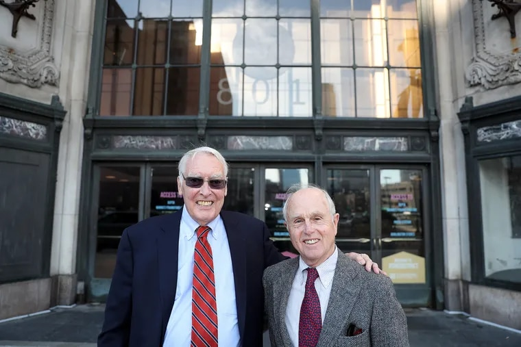 """Frances """"Frank"""" Strawbridge, left, poses for a portrait with his cousin, Peter Strawbridge, outside of 801 Market Street, formerly Strawbridge's department store, in Philadelphia, PA on November 26, 2019. Frances was the store's chairman and Peter was the president. A historic marker is going to be placed outside the former main entrance."""