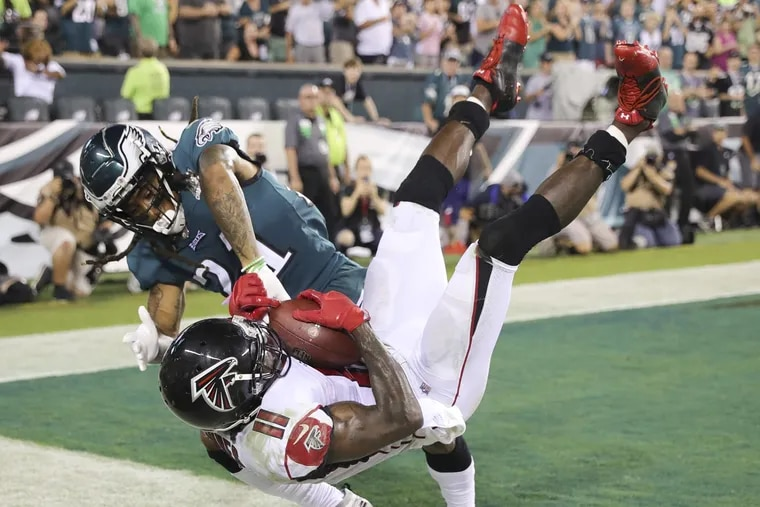 Eagles cornerback Ronald Darby makes sure the Falcons' Julio Jones can't get his feet down on the final play of the game.
